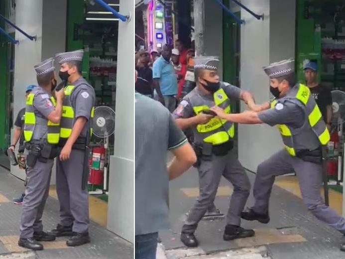 IMAGEM: PM aponta arma para colega em briga no centro de SP